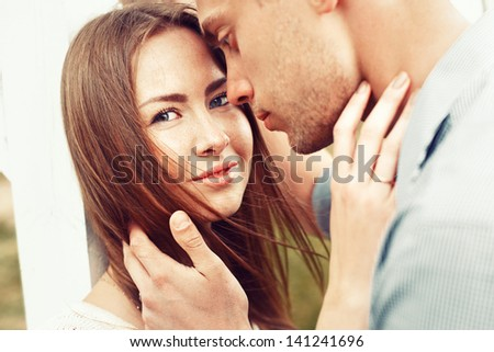 Closeup fashion vintage portrait of young couple in love