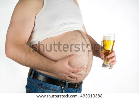 closeup fat belly with beer isolated on white background.