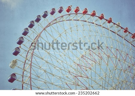 Closeup ferris wheel over blue sky with filtered - stock photo