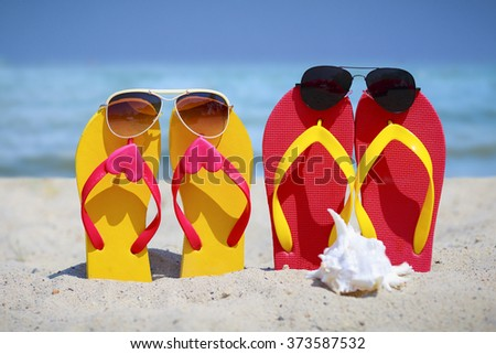 closeup flip flops on the beach - stock photo