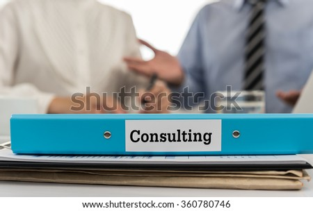 Closeup folder consulting with lawyer consulting services, legal and business in background. selective focus. - stock photo