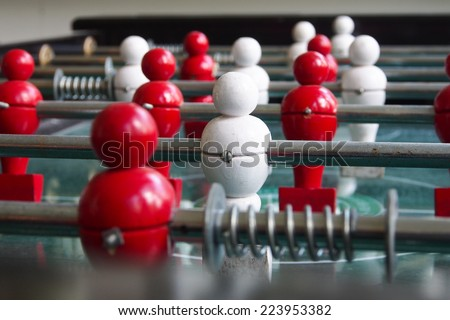 Closeup football table game with red and white player - stock photo