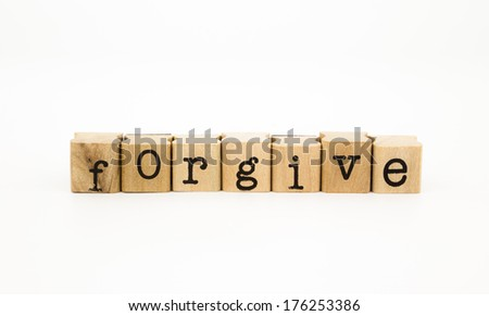 closeup forgive wording isolate on white background, ethic and merit concept and idea - stock photo