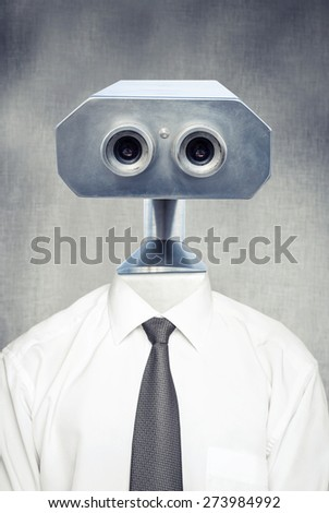 Closeup frontal portrait of vintage robot android in white shirt with classical tie over gray background - stock photo