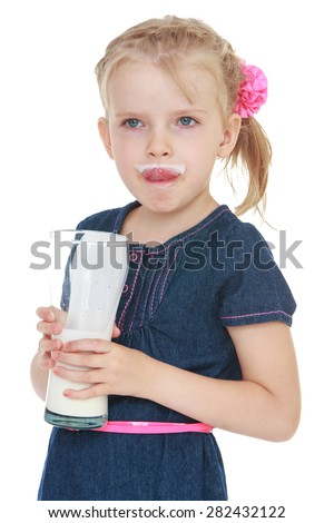 Closeup funny blonde girl drinking from a glass of yogurt- isolated on white background - stock photo