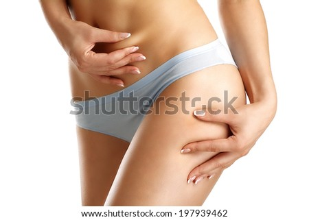 Closeup girl in underwear pich her belly  on white - stock photo