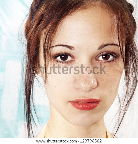 closeup girl's face with freckles, sight to camera - stock photo