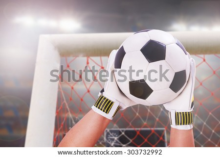 closeup goalkeeper super save on stadium light - stock photo