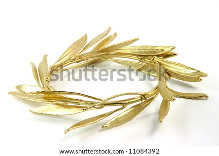 closeup gold winner olive tree wreath for olympic games winners isolated on white background