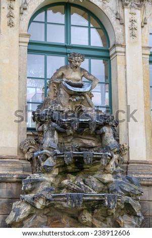 Closeup half naked faunus statues fountain at Zwinger palace in Dresden, Germany  - stock photo