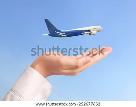 Closeup hand holding an airplane model - stock photo