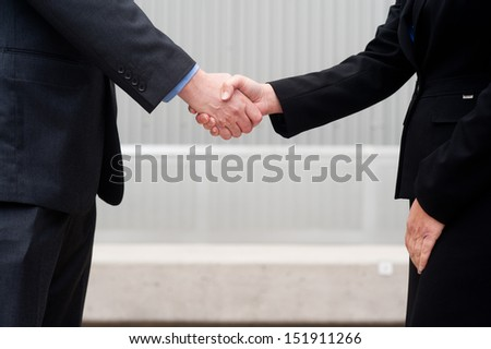 closeup handshake isolated on business background