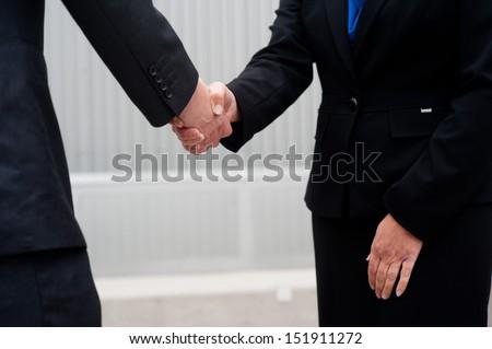 closeup handshake isolated on business background - stock photo