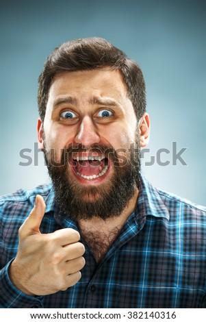 Closeup headshot portrait, happy handsome business man in blue shirt - stock photo