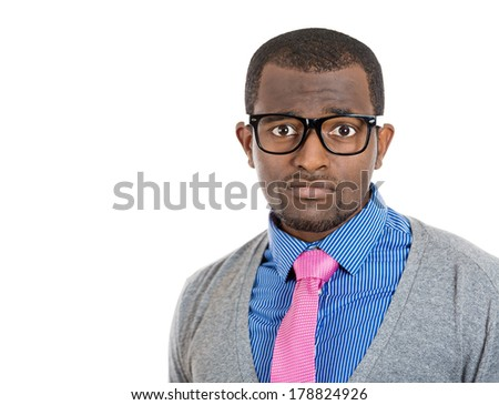 Closeup headshot portrait of handsome nerdy young man with serious concerned look on his face, isolated on white background. Negative emotion facial expression feelings, reaction, perception - stock photo