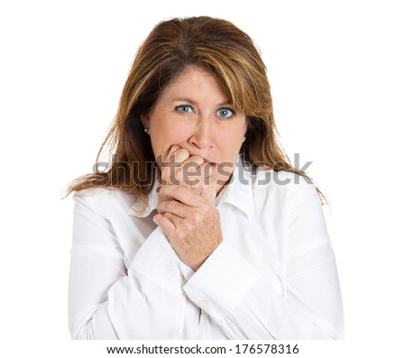 Closeup headshot portrait of young unhappy, scared woman anxious female biting nails looking with craving, envy for something, worried, isolated on white background. Human face expressions, emotions - stock photo
