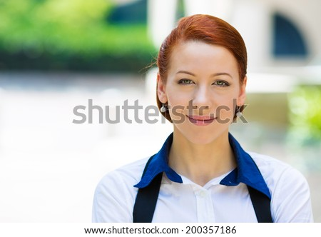 Closeup headshot portrait young beautiful business woman in white shirt smiling isolated urban, city street background on sunny day. Positive human emotion, facial expression attitude, life perception - stock photo