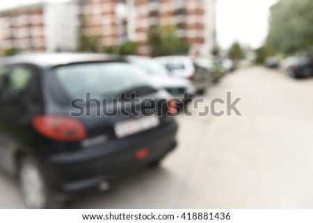 Closeup horizontal photo shoot of parked cars on the street, blurry photo, modern transportation