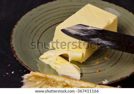 Closeup image of a butter knife and butter. - stock photo