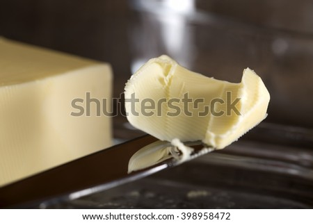 Closeup image of a butter knife and butter - stock photo