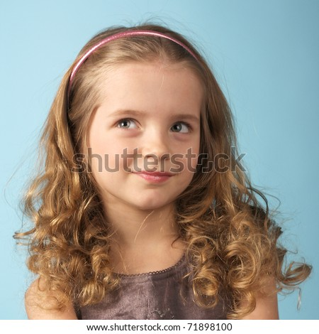 closeup image of a curly pretty little girl