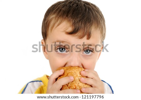 Closeup image of a cute kid eating sandwich - stock photo