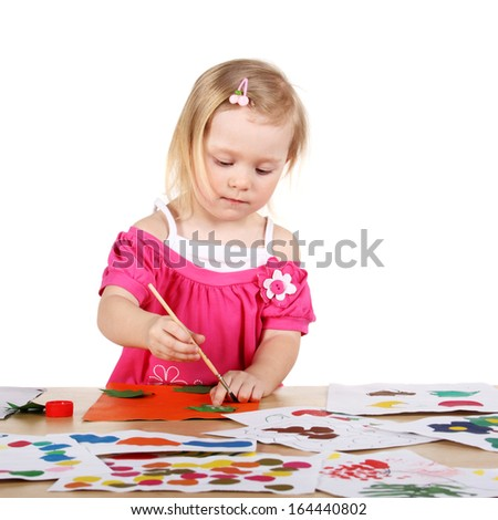 closeup image of a cute little child creating something