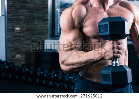 Closeup image of a muscular man workout with dumbbell - stock photo