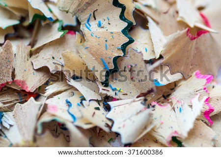 Closeup image of brightly coloured school pencil sharpening shavings on a white background. Copyspace for educational reference or education themed designs.