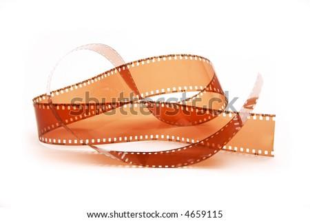 Closeup image of curling 35mm film - stock photo