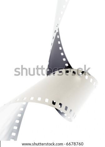 Closeup image of curling 35mm film. - stock photo