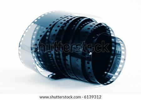 Closeup image of curling 35mm film in blue tones - stock photo