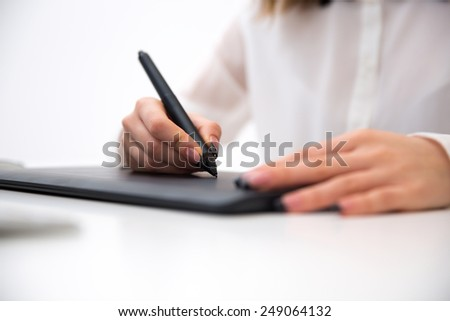 Closeup image  of female hands working on graphic tablet - stock photo