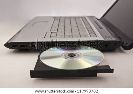 Closeup image of laptop with open DVDROM - stock photo