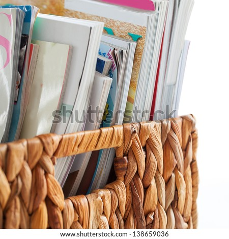 Closeup image of magazines in a straw pleated  box - stock photo