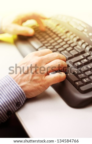 Closeup image of male hands typing - stock photo