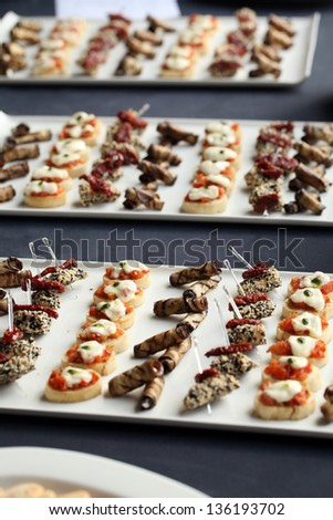 Closeup image of restaurant gourmet snacks in a plate - stock photo