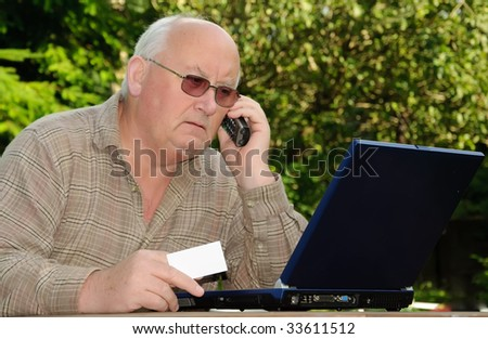 closeup image of senior online shopping using laptop and credit card, advert on white card or laptop - stock photo