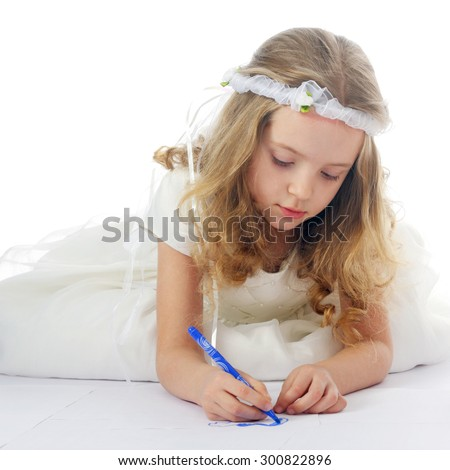 closeup image of the beautiful little pretty girl drawing
