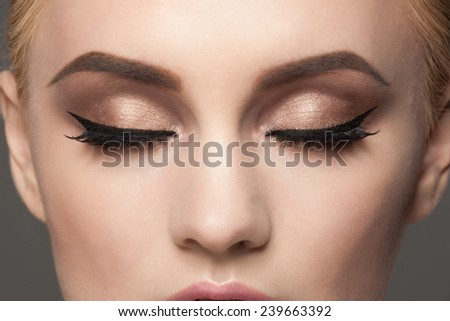 Closeup image of woman closed eyes with beautiful bright makeup.  - stock photo