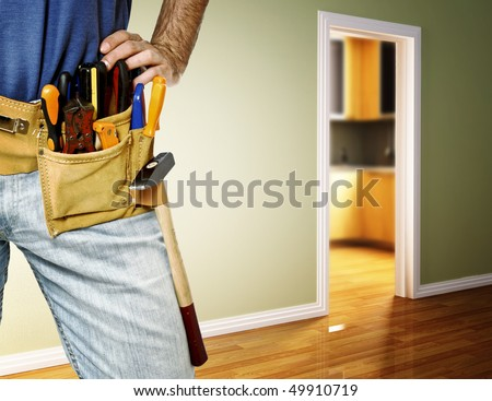 closeup image on classic leather tool belt of handyman - stock photo