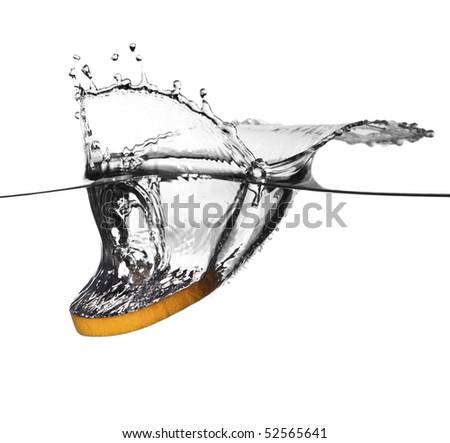 closeup image on orange splash in a water - stock photo