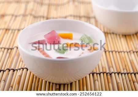 Closeup images of thai fruit salad of fresh fruit in bowl on  mat