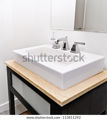 Closeup interior of bathroom vanity and mirror - stock photo