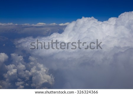 Closeup large fluffy clouds in the sky - stock photo