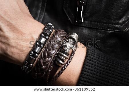 closeup leather bracelet on man's wrist - stock photo