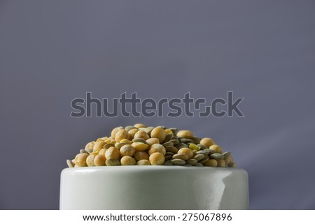 Closeup Lentils in a white bowl / Closeup Lentils - stock photo