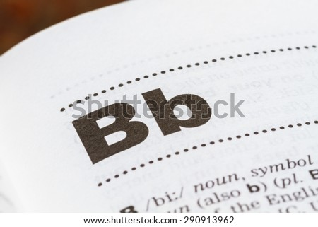 closeup letter B in dictionary, soft focus, - stock photo