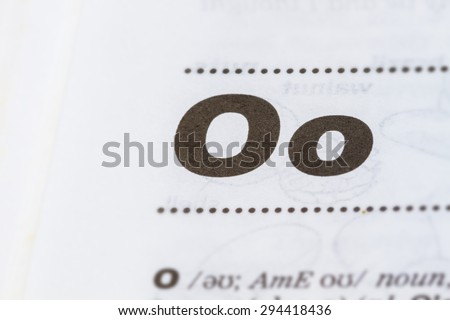 closeup letter O in dictionary, soft focus, - stock photo