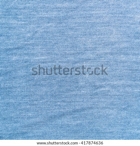 Closeup light blue jeans denim abstract background with copy space. - stock photo